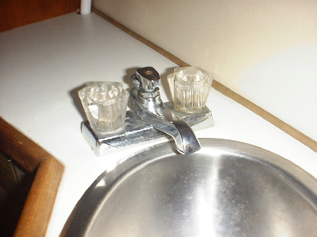 This Is The Old Sink Faucet With Shower Diverter.